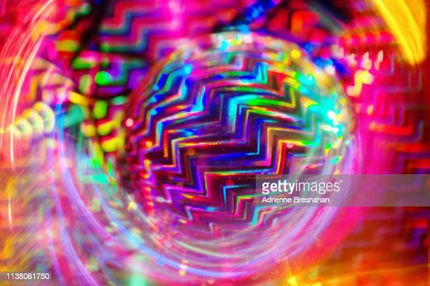 psychedelic zig zag orb - funky stock pictures, royalty-free photos & images