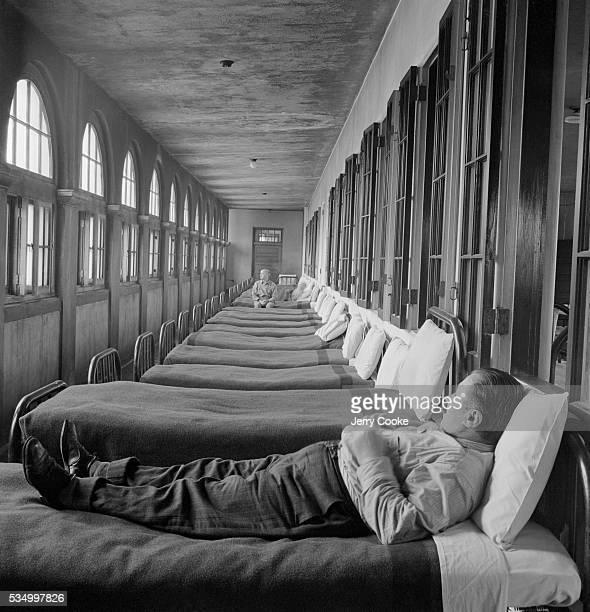 Psychiatric Patient in Asylum Sleeping Area