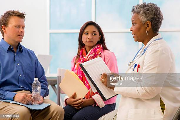 Psychiatrist counseling session with man, woman patients. Therapy.