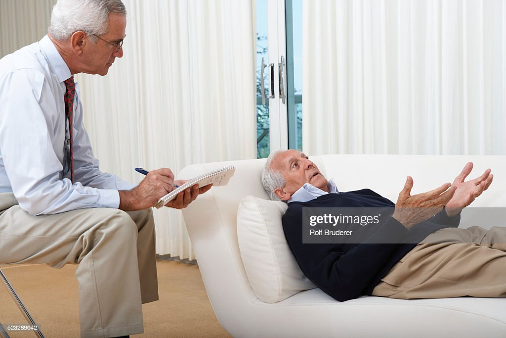 Psychiatrist Treating Senior Man : Stock Photo
