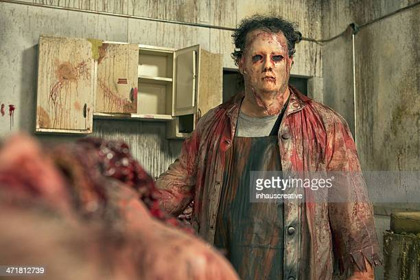 psycho butcher in his deadly kitchen - human intestine stock photos and pictures