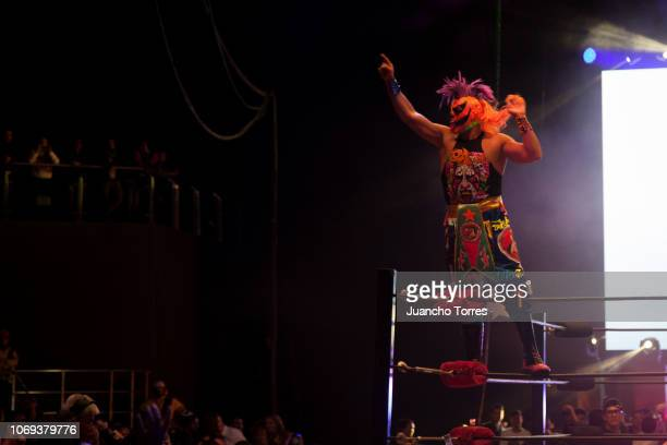 Psycho Clown prepares to jump from the ropes during an AAA World Wide Wrestling match on November 16 2018 in Bogota Colombia