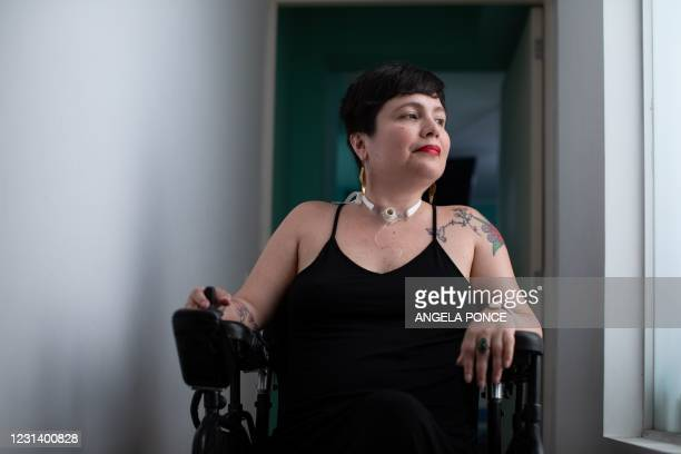 Psychologist Ana Estrada, who has suffered from incurable and progressive polio since the age of 12, poses for pictures at her house in Lima, on...