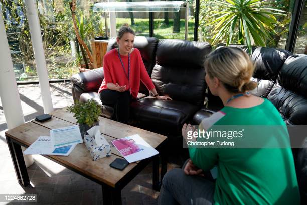 Psychologist Dr Louise Oakley chats to a member of staff in the Wrexham Maelor Hospital staff wellbeing and support centre where funding from local...