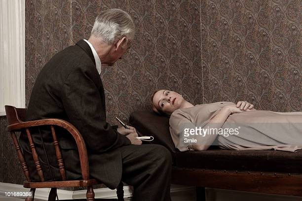 Psychologist listening to female patient