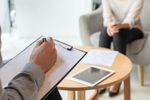 Psychologist understanding problems of a woman patient 1169696855