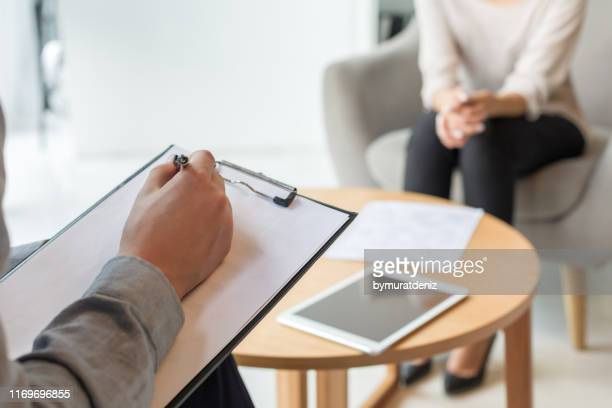 psychologist understanding problems of a woman patient - counseling stock pictures, royalty-free photos & images