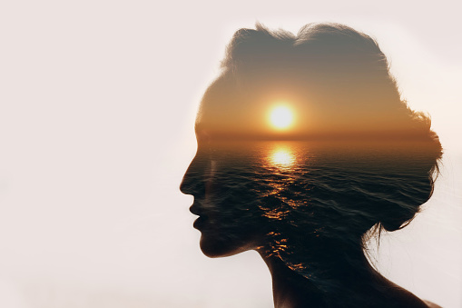 Psychology concept. Sunrise and woman silhouette. 1003610768