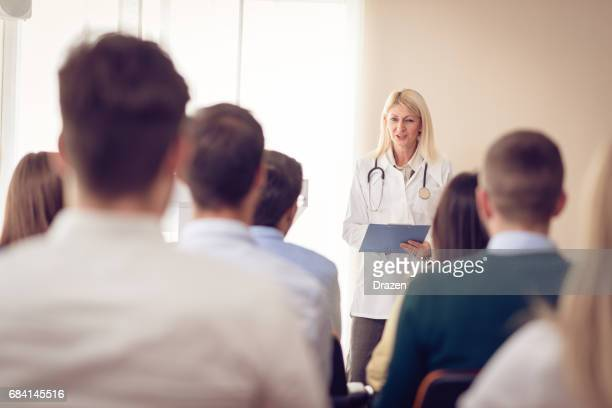 psychology professor and students in classroom - congress stock pictures, royalty-free photos & images