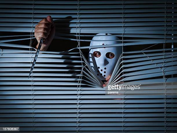 psychopath behind blinds. - insanity stock pictures, royalty-free photos & images