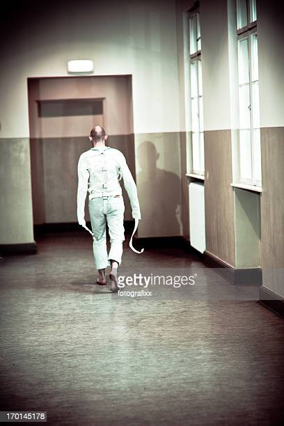psychopath in a straight jacket - straight jacket stock pictures, royalty-free photos & images