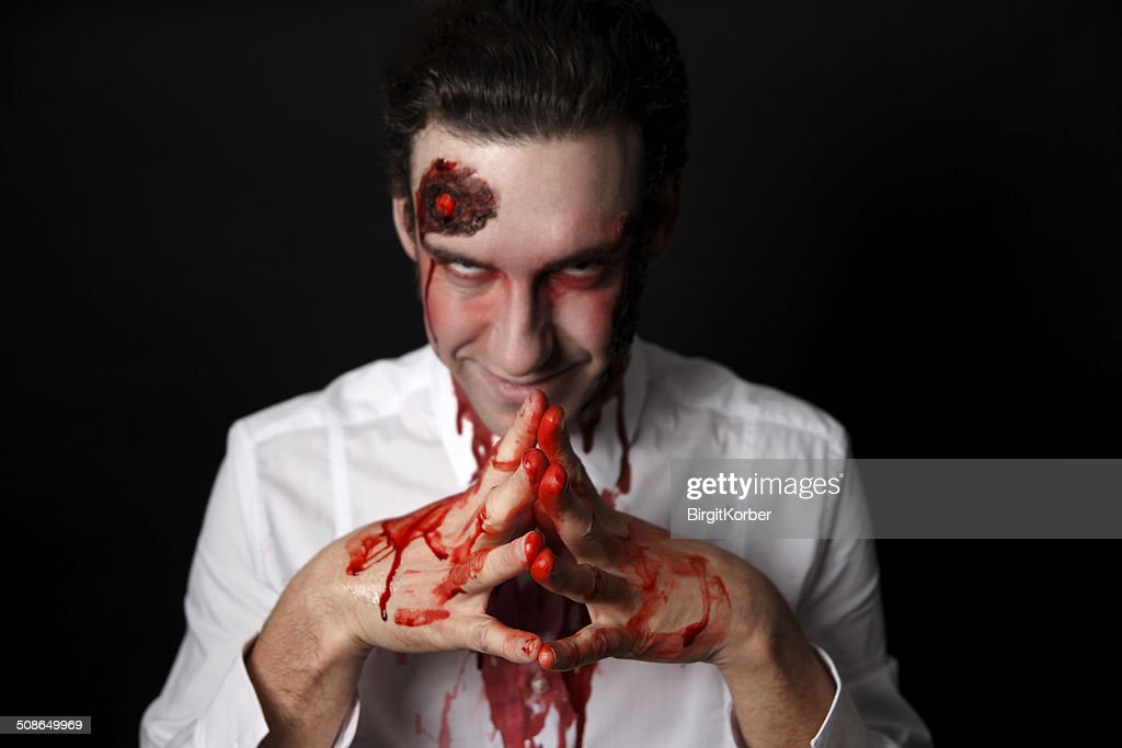Psychopath with bloody hands : Stock Photo