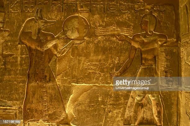 Ptolemaic temple of Hathor and Maat Polychrome reliefs that decorate the interior Anubis Deir elMedina Egypt