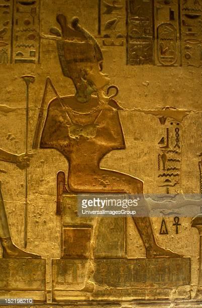 Ptolemaic temple of Hathor and Maat Polychrome reliefs that decorate the interior God Osiris Seated figure Deir elMedina Egypt