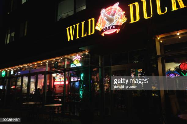 pub at night - eugene oregon stock photos and pictures