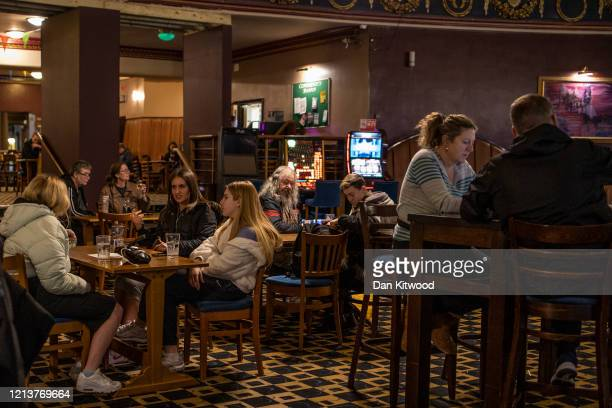 Pub goers enjoy a final evening of drinking in a JD Weatherspoon's on March 20 2020 in London United Kingdom British Prime Minister Boris Johnson...