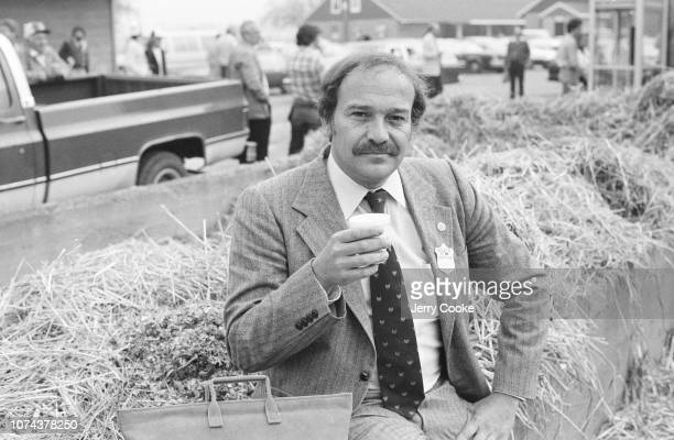 SI Writer Bill Nack posing in front of a stack of hay at the Churchill Downs stable Louisville KY CREDIT Jerry Cooke