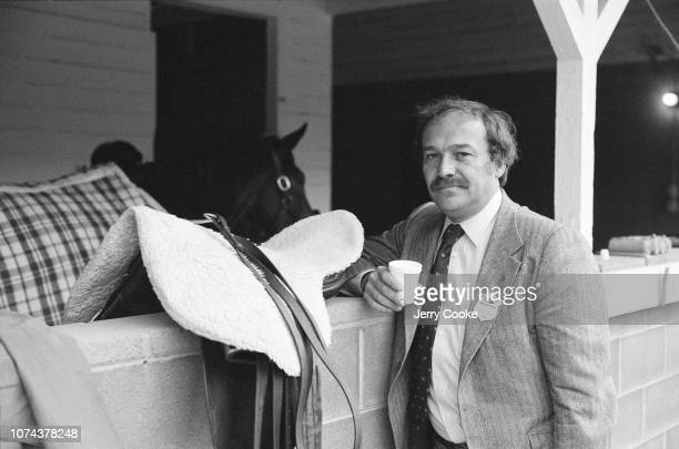 SI Writer Bill Nack posing near stable at Churchill Downs Louisville KY CREDIT Jerry Cooke