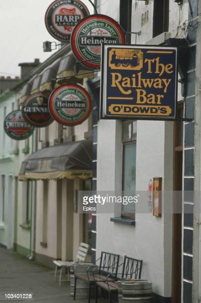 Pub Signs advertising Guinness Heineken Harp and 'O'Dowd's Railway Bar' in County Leitrim Ireland circa 1980