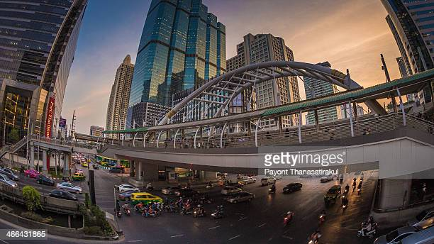 CONTENT] pubic skywalk at bangkok downtown square night in business zone