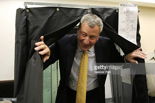 Public Advocate and mayoral candidate Bill de Blasio emerges from a voting booth after voting in the New York City mayoral primary on September 10...