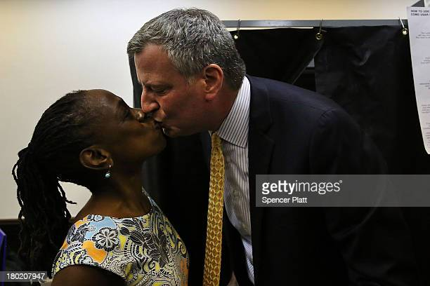 Public Advocate and mayoral candidate Bill de Blasio kisses his wife Chirlane McCray after voting in the New York City mayoral primary on September...