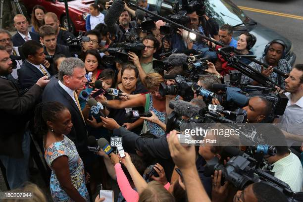 Public Advocate and mayoral candidate Bill de Blasio speaks to the media while standing with his wife Chirlane McCray after voting in the New York...