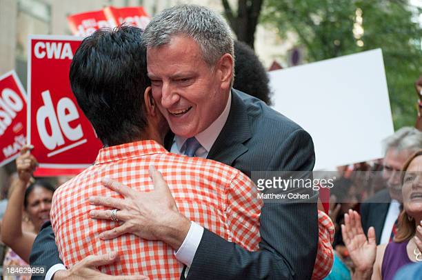 Public Advocate and Mayoral frontrunner Bill de Blasio , hugs a voter while greeting the crowd before the final debate of the primaries.