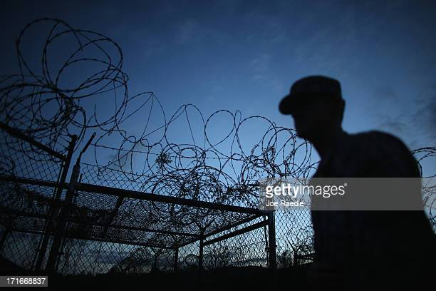 Public Affairs Officer escorts media through the currently closed Camp X-Ray which was the first detention facility to hold 'enemy combatants' at the...