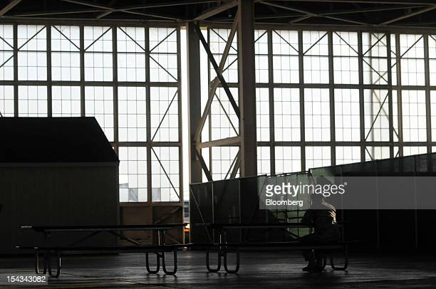 A public affairs officer talks on the phone inside the media hangar at Camp Justice at the US naval base at Guantanamo Bay Cuba on Wednesday Oct 17...