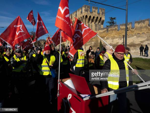 Public and private workers demonstrate and shout slogans during a mass strike against pension reforms on December 10, 2019 in Avignon, France. French...