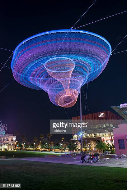 public art sculpture phoenix at night her secret is patience - phoenix arizona stock photos and pictures