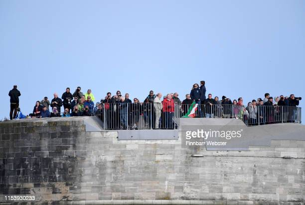 Public at a viewing area as veterans depart Portsmouth on MV Boudicca to Normandy retracing the voyage they made across the Channel 75 years ago on...