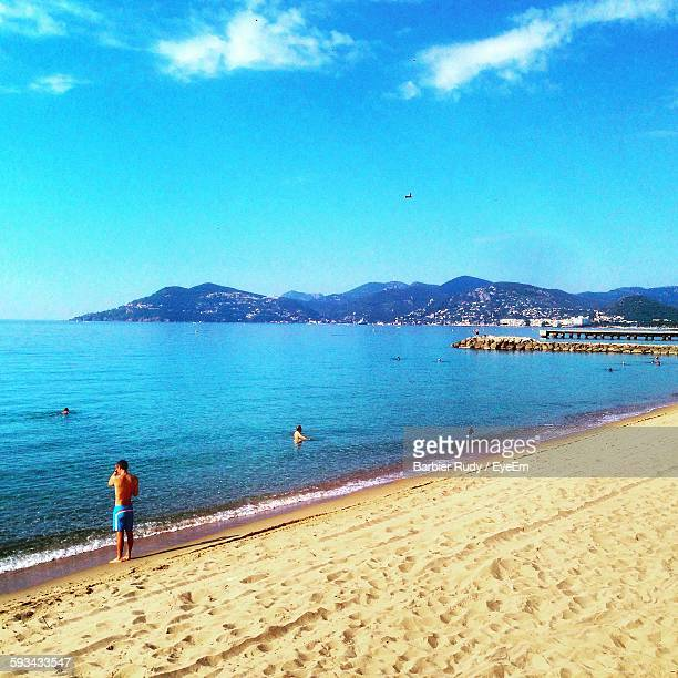public beach at sunny day - antibes stock photos and pictures