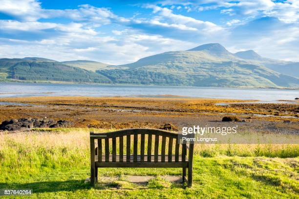 public bench on loch scridain with view to ben more and glen more mountains early morning in summer - isle of mull, inner hebrides, scotland - dramatic landscape stock pictures, royalty-free photos & images
