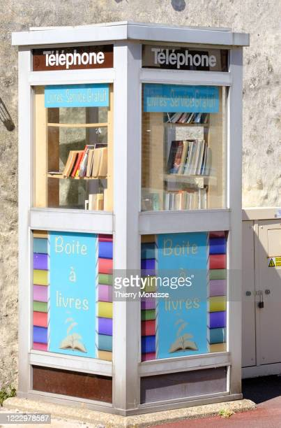 Public Bookcase installed in a previous french Telephone booth is seen on June 24 in Le Crotoy France A microlibrary is an element of urban furniture...