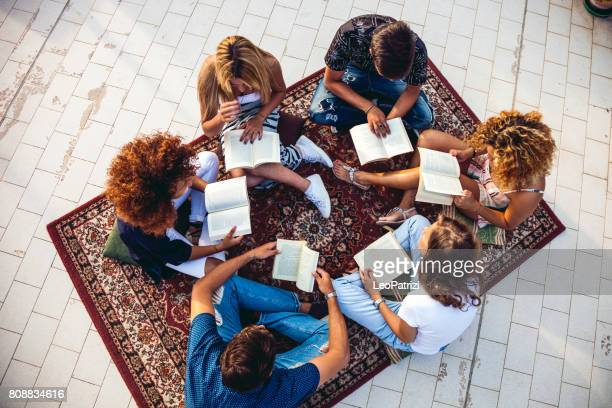 Public books reading with friends
