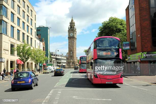 a public bus driving along high street with the albert memorial clock tower in the background - rainer grosskopf stock pictures, royalty-free photos & images