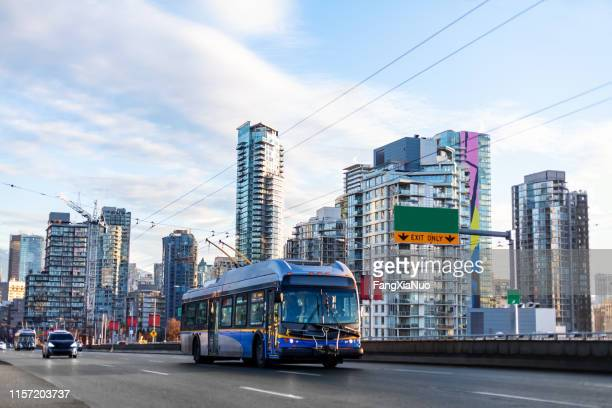 public bus on granville street bridge leaving downtown vancouver - vancouver canada stock pictures, royalty-free photos & images