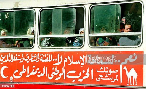A public bus with slogans supporting the ruling National Democratic Party makes its way through Cairo 09 November as Egypt will go to the polls 29...