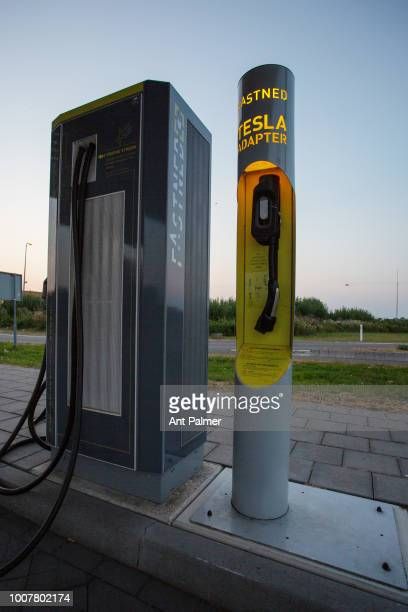 Public charging station from FASTNED located by a roadside on July 25 2018 in The Hague Netherlands The station also included adaptors for Tesla...