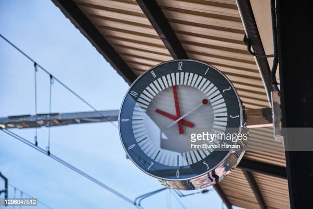 public clock at railway station at for watch time waiting train - finn bjurvoll stock pictures, royalty-free photos & images