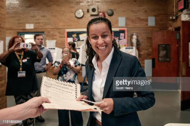 Public defender Tiffany Caban a candidate for Queens district attorney votes at PS 122 on the day of the borough's Democratic primary election June...