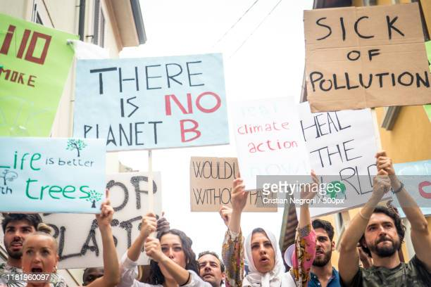 public demonstration on the street against global warming - climate stock pictures, royalty-free photos & images