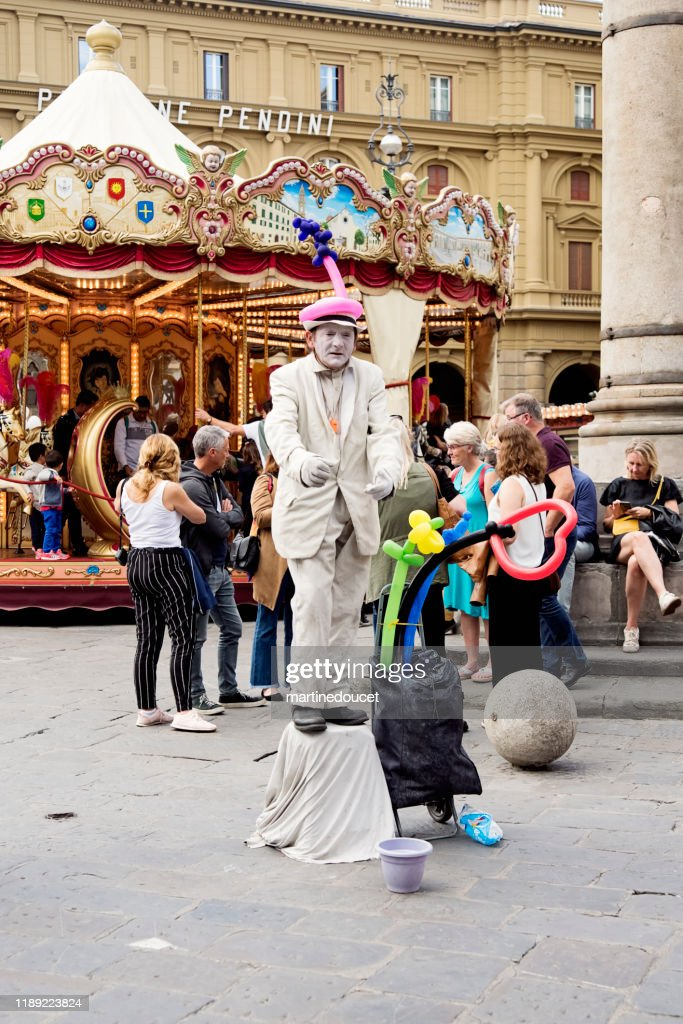 Public entertainer in the streets of Florence Italy : Stock Photo