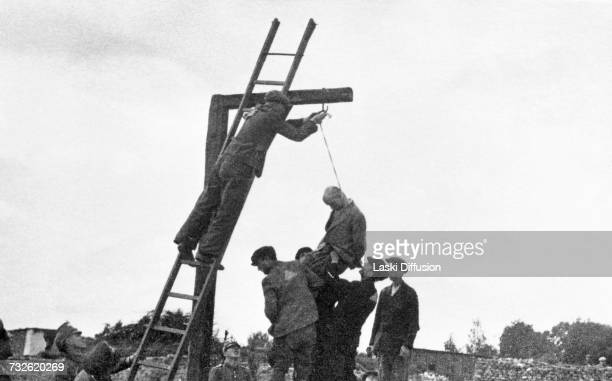 A public execution of a Polish black marketeer in Sanniki in Germanoccupied Poland A photo from an album documenting German atrocities in occupied...