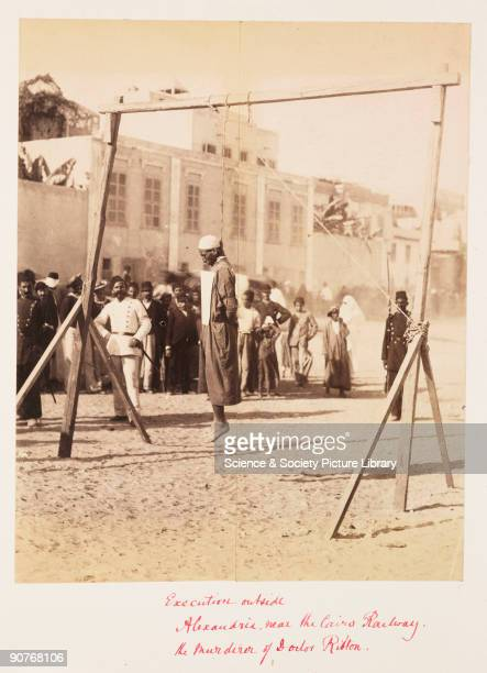 Public execution outside the railway station in Alexandria A small crowd has gathered to view this gruesome scene This man was executed for the...