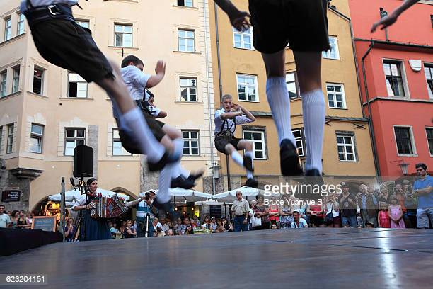 public folk dance show in old town - traditional ceremony stock pictures, royalty-free photos & images