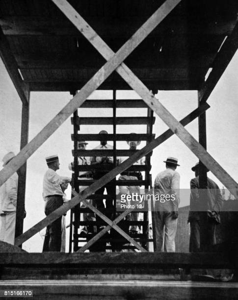 A public hanging in Kentucky USA A twentytwo year old black man convicted of the assault and murder of an old woman is led up the gallows steps