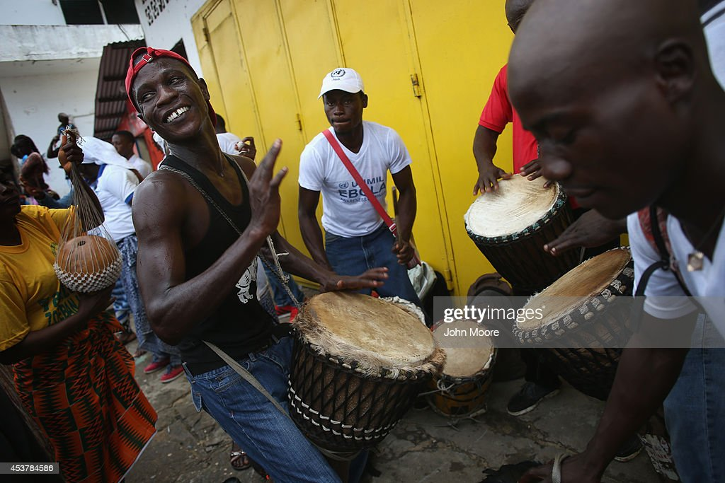 Public health advocates play music to attract people for an Ebola awareness and prevention event on August 18, 2014 in Monrovia, Liberia. The Liberian government and international groups are trying to convince residents of the danger and are urging people to wash their hands to help prevent the spread of the epidemic, which is spread by bodily fluids. The virus has killed more than 1,000 people in four African countries, and Liberia now has had more deaths than any other country.